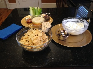 Hummus, Tzatziki, marinated olives, and dried fruit.
