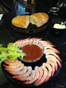Fresh baked bread and butter and Bloody Mary shrimp.