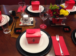"""The ladies' place setting. My sticker was """"joy"""". So cheesy that I love it.  I really liked how the red on the bottom of the glass really pops out at you."""