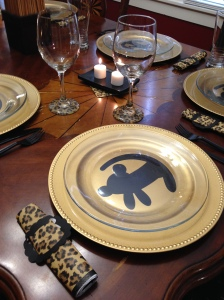 Place setting for The Lion King including Simba vinyl and mod podg-ed glasses.