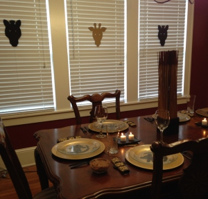 """Tablescape with """"masks"""" added to the windows to help the """"lodge"""" feel."""