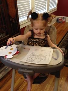 Jacs enjoying coloring her Simba pages.