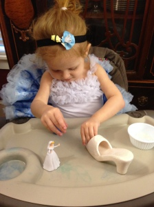 Cinderella crafting her glass slipper.